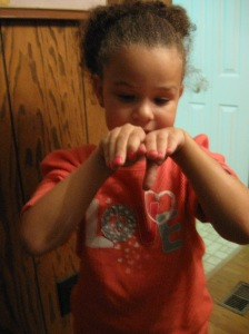 Jordan, my six-year-old sister, and her fro- and hot pink fingernails!